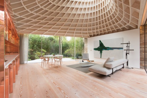 """Designed, modeled and fabricated using both digital and manual processes each feeding the other, the intensity of the complex timber roof structure belies its warm domestic scale and character,"" Gianni Botsford says."