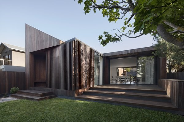 The home is clad in sustainably sourced spotted gum. A natural material palette is used throughout.