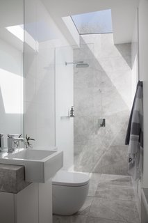 The light-filled ensuite bathroom includes a Nickles showerhead and MIZU taps.