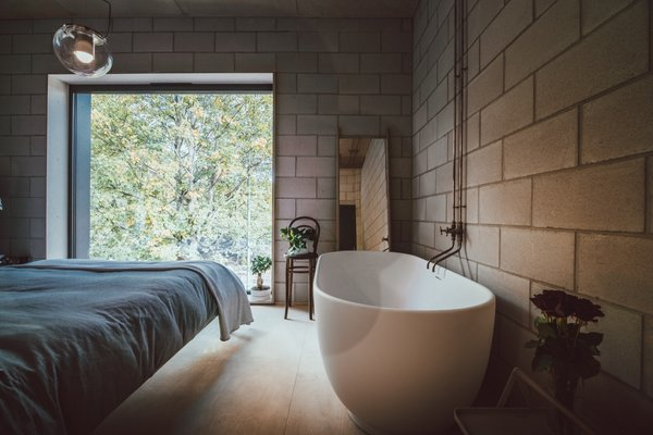 Tucked behind the galley kitchen is Jon and his partner's master bedroom that overlooks views of the valley.