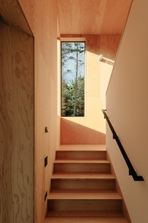 The light-filled stairway leads up to the an office and master bedroom.