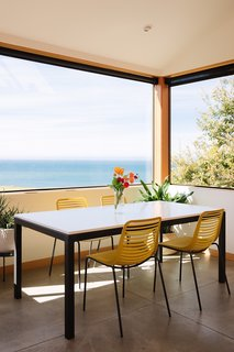 The eat-in kitchen features a dining space that overlooks spectacular views of the Pacific Ocean.
