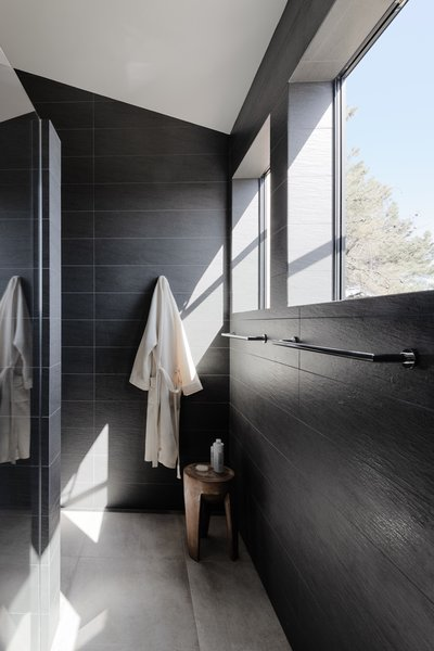 Porcelanosa tiles line the walls and floor of the master bath.