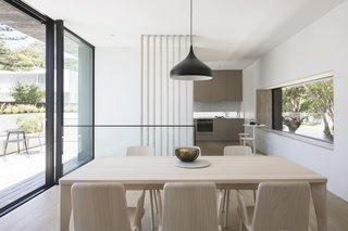 A Sipa Fold Rectangular Table and Sipa armchairs in natural ash outfit the dining area.