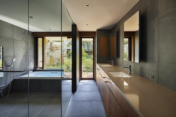 The minimalist bathrooms feature Silestone quartz countertops and tiled floors.