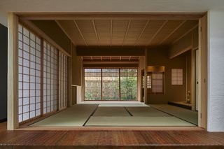 A traditional tatami room with shoji sliding doors is located next to the open-plan living space.