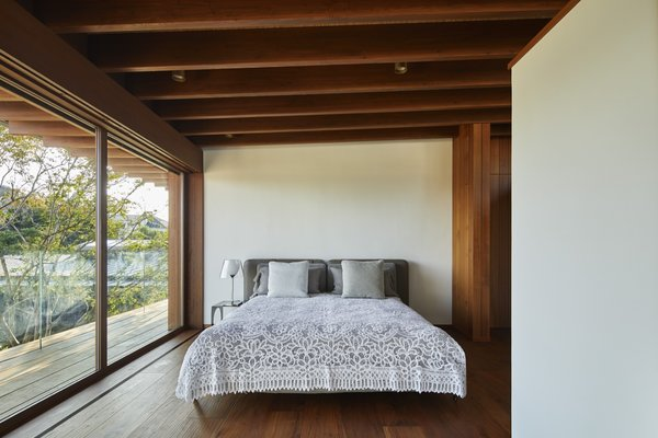 The Lath House consists of four bedrooms, three of which are located upstairs. The ceilings are natural bamboo.