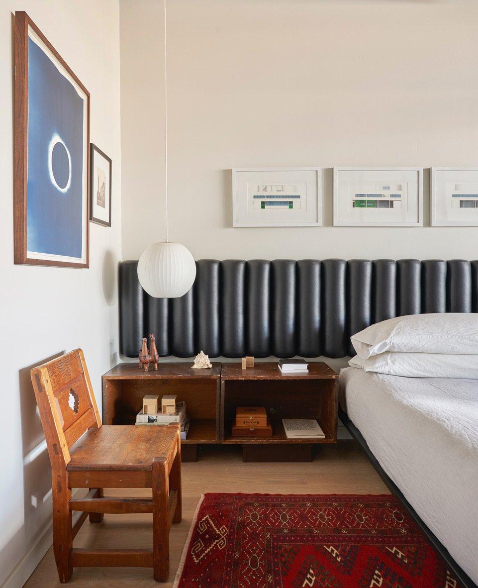 West Loop Loft bedroom with tufted headboard