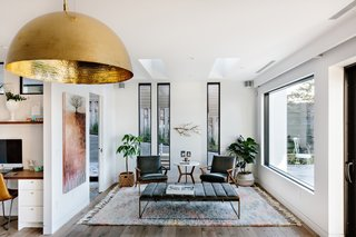 An abundance of glazing pours light into the house. Hardwood floors are used throughout the home.