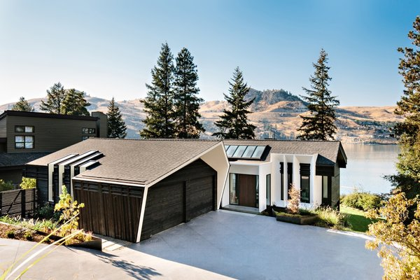 "Nicknamed the ""lake of a thousand colors"" for its brilliant coloration, Kalamalka Lake was a driving inspiration behind the home's redesign. In a playful nod to the lengthy renovation process, the remodeled house, which now embraces views of the lake, has also been dubbed the ""house of a thousand alterations."""