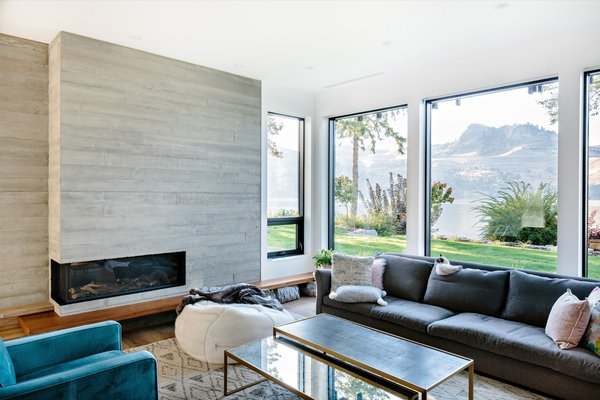 Board-formed concrete punctuates the home, including in the living room, where it frames the fireplace. The sofa is by Montauk.