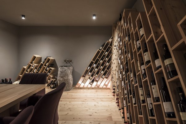 The new wine cellar references jagged mountain peaks with its geometric wooden shelving.