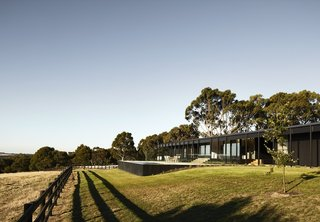 The house faces west for views of the fields and valley beyond.