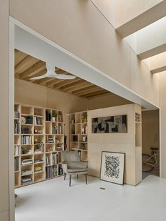 For just under $102,000, Anya Moryoussef Architect transformed a single-car garage into a multifunctional workspace that's wrapped in Baltic birch plywood.