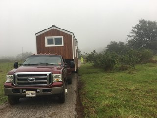 Set on wheels, the 350-square-foot tiny house can be towed with a truck. Despite the mobile nature of the dwelling, the couple installed drywall to achieve a smooth, clean finish on the interior; a few cracks did appear after moving the home, but the couple both agree the drywall was worth it.