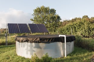 The 3,000-gallon rainwater catchment tank is by Eco Products Maui while the solar panels are from altE Store.