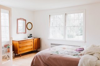As with all the bedrooms, the master bedroom was painted Chantilly Lace by Benjamin Moore. The floors were also refinished.