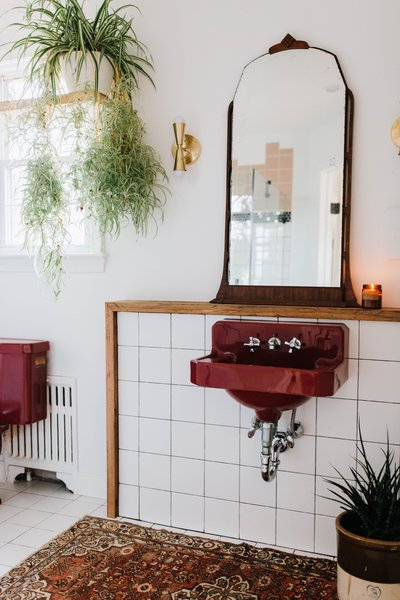 The new master bathroom was expanded. The maroon sink was moved to a new location and has a more sculptural feel.