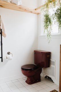 When Chris and Claude bought the home, the maroon toilet was mismatched with a white toilet lid. Although they couldn't find an exact match (even after five tries), the new lid is a much better match than the white.