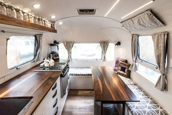 After two years at sea with their family of five, a couple continues their tiny house lifestyle by renovating a rundown Airstream.