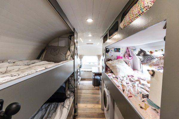 """""""The overall decor was pure white with dark grey for the kid's area to make the area feel spacious,"""" the couple says. """"Dark wood was incorporated for a contrast accent."""""""