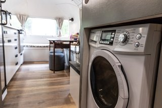 The laundry machine is strategically centered above the axles for optimal weight distribution.