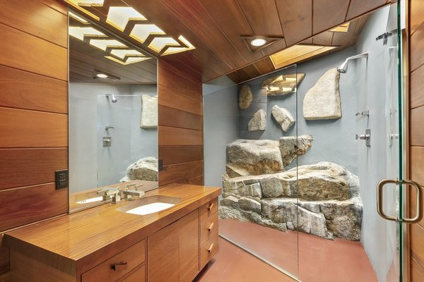 Massive stones have also been embedded into the guest bathroom.