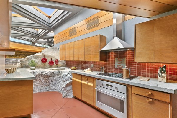 """A smaller """"tail rock"""" off of the """"whale rock"""" makes an appearance in the kitchen."""