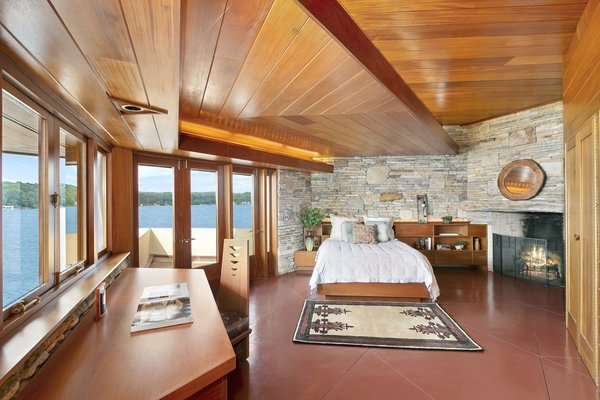 The master bedroom overlooks panoramic views of the lake.