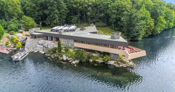 Fifty miles north of New York City, a private island with a controversial home and guesthouse built from Frank Lloyd Wright's drawings seeks a new buyer.