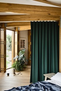 Instead of walls, curtains are used for privacy.