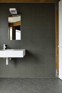 Mutina Phenomenon porcelain stoneware tiles line the bathroom walls and floors.