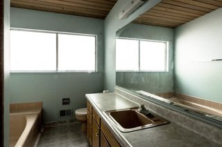 While the existing bathroom layout was perfectly usable, dated surface materials were swapped for a more contemporary look.