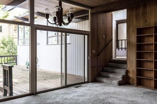 Wrapped in wood paneling and lined with old carpet, the dining area felt dark and stuffy before the renovation.