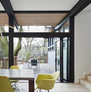 Folding glass doors creates a more seamless connection between the dining room and the outdoor deck.