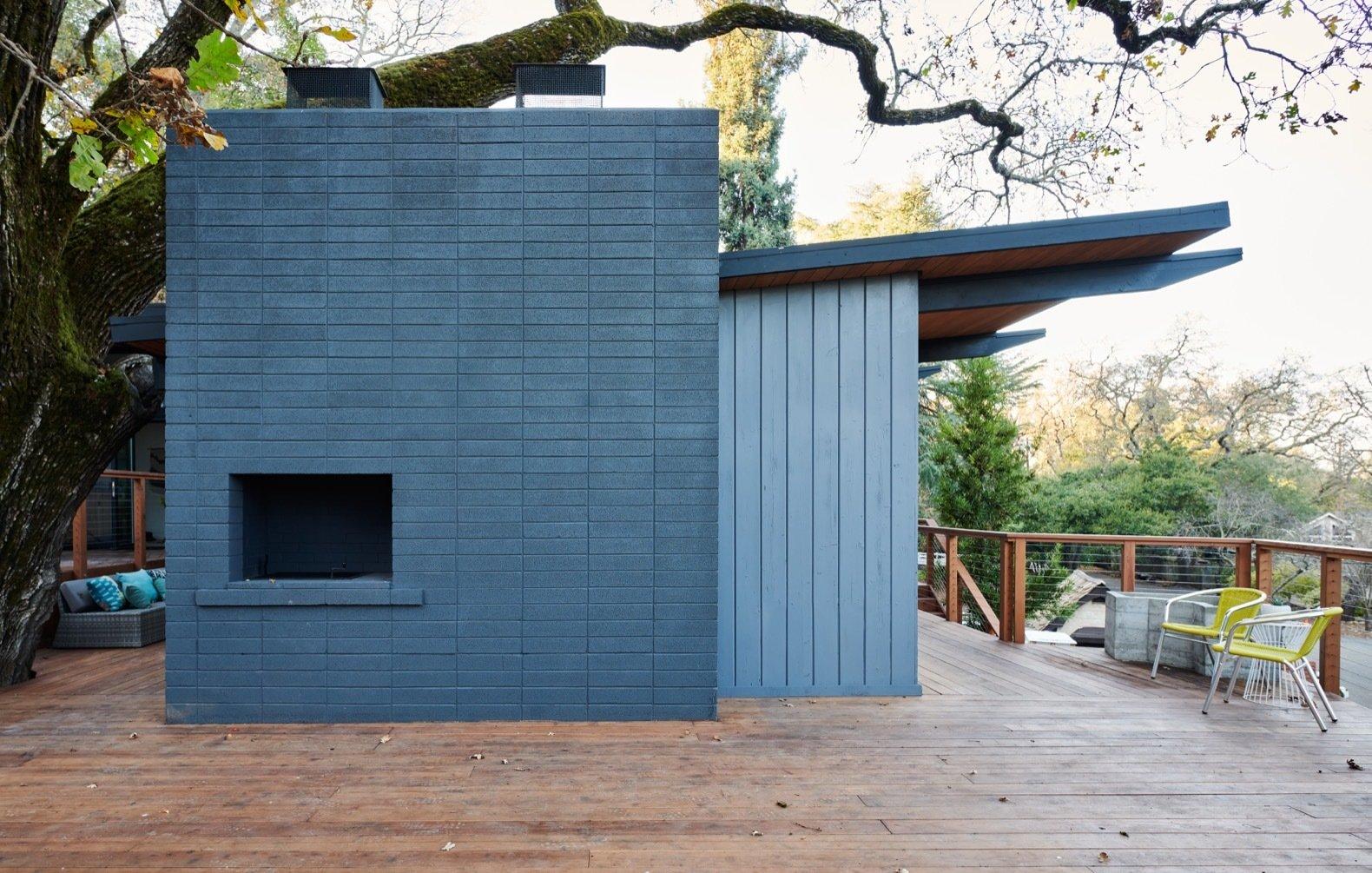 after: midcentury hillside remodel exterior fireplace