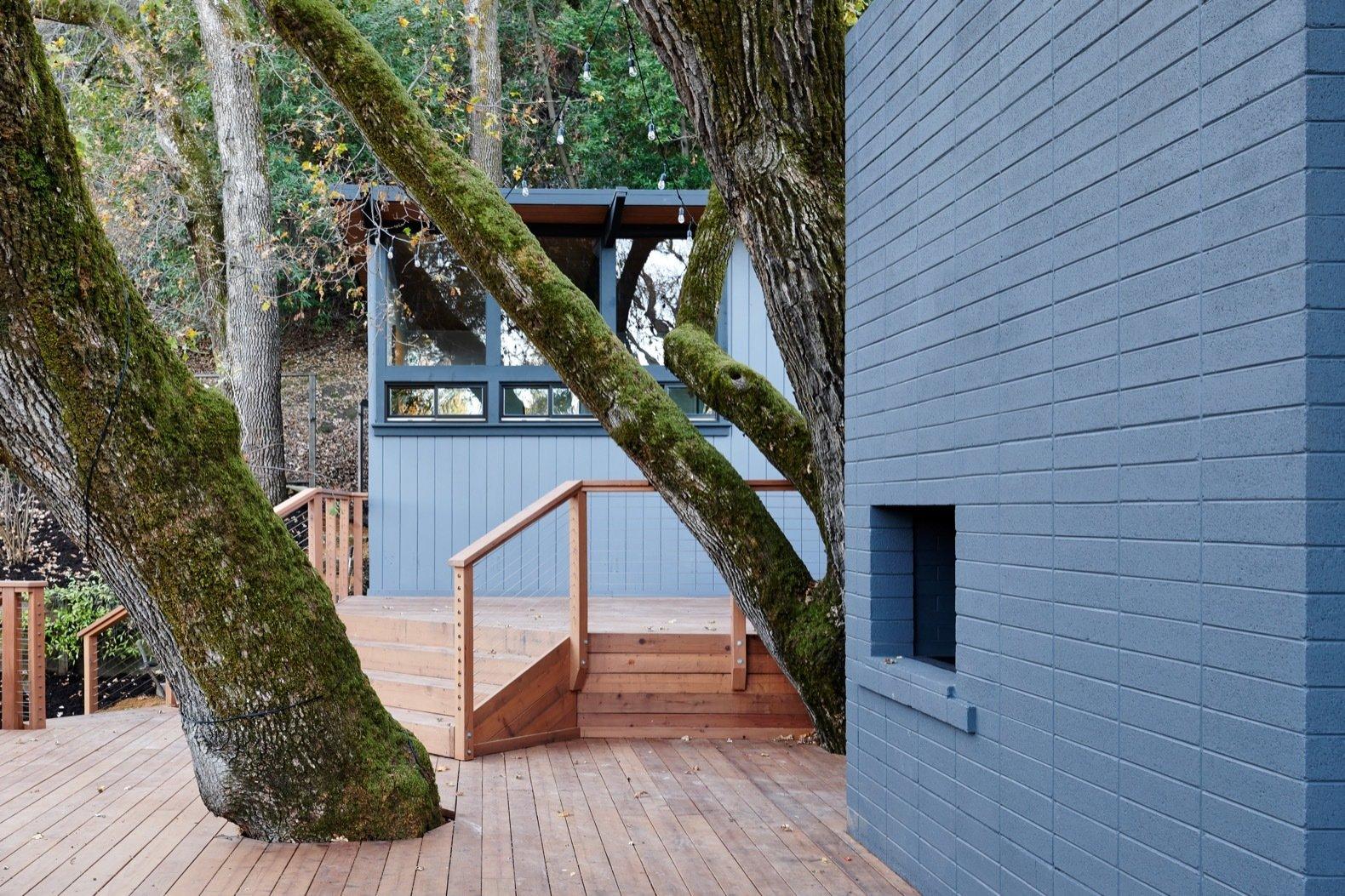 after: midcentury hillside remodel deck