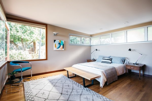 Anchored by a vintage Thonet cantilever chair, the master bedroom is filled with natural light and views of the outdoors.