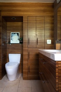 The bathroom cabinetry is made of Zebrawood. The floor is limestone tile.