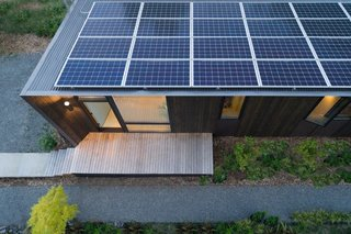 Angled towards the sun, the solar panels meet all of the studio's energy needs with enough energy left over to power the adjacent house.