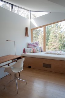 """Catherine's favorite space in the house is this second-floor study by the master suite. """"It's a great lounge area with a view of the lake,"""" she says. """"Everybody wants to go up there and read a book."""""""