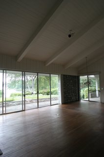 Before: The floors in the living area sagged and needed to be replaced. All windows and sliding glass windows were upgraded in the renovation.