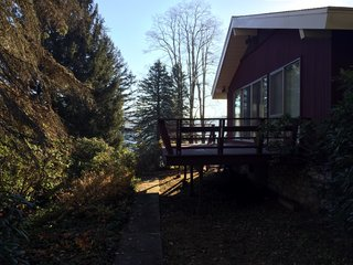 Before: Previously, the north side of the home housed a single bedroom, bath, and outdoor deck with lake access.