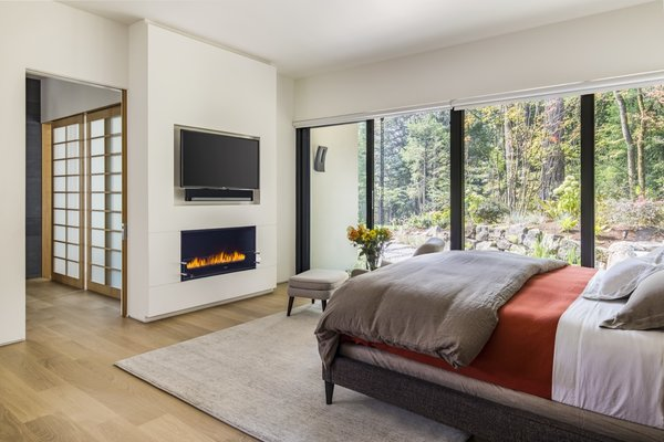 Sliding doors in the master bedroom open to an outdoor walkway that connects to the outdoor spa, patio, and garden.