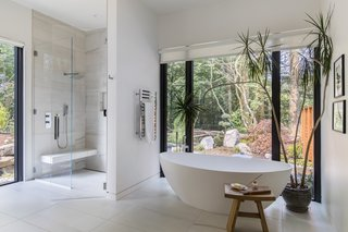 The master bath includes a Badeloft freestanding tub and Aquabrass fixtures.