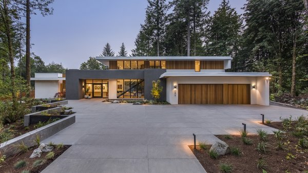 """""""Great care was taken to preserve all fir and maple trees on the site and to compliment the new landscaped areas to highlight the natural setting,"""" the architects note of their site-sensitive approach."""