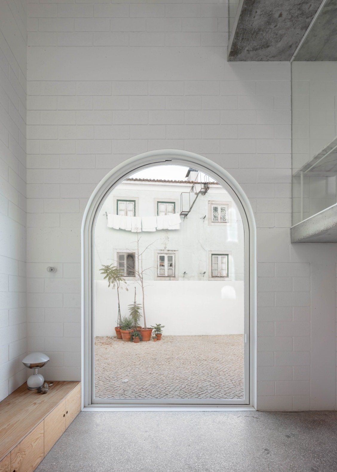 Dodged House arched pivot door