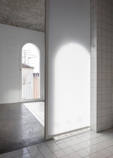The translucent sliding bathroom door allows light to filter through.