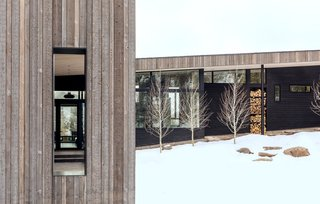 The exterior is clad in pre-finished inland cedar and shou sugi ban-charred wood.