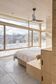 A peek inside the master bedroom that faces panoramic mountain views.